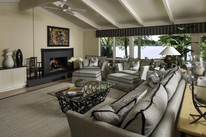 Appealing Steel Coffee Table With Glass Top And Black Trim Couches As Oversized Couches On Tan Woven Carpet Plus Unique Table Lamp For Contemporary Great Living Room With Ceiling Fan On Vaulted Ceiling