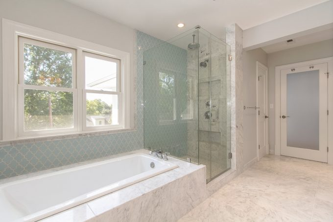 Arabesque Tile With Recessed Lighting Also Rectangular Soaking Tub And Double Hung Window With Rain Shower Head Also Glass Shower Doors For Traditional Bathroom