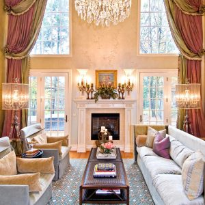 Arched Window On Window Treatments For Large Windows With Oversized Curtains And Beige Patterned Wallpaper Pus Crystal Chandelier In Luxury Home With Sofa And Brown Coffee Table On Blue Patterned Rug