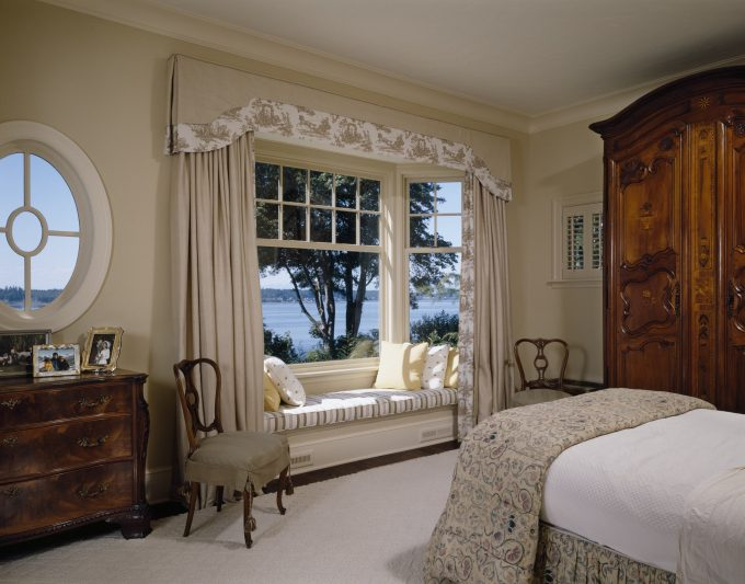 Armoire And Slipcover On Wood Chairs Near Window Treatments For Large Windows In Traditional Bedroom With Beige Wall And Crown Molding Plus Tropical Bedding On Tween Bed