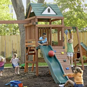Backyard Design Ideas With Backyard Fence Plus Swing Sets For Children Playground In Under Big Tree With Plants And Grass Plus Wood Dog House Also Outdoor Space For Pet Area