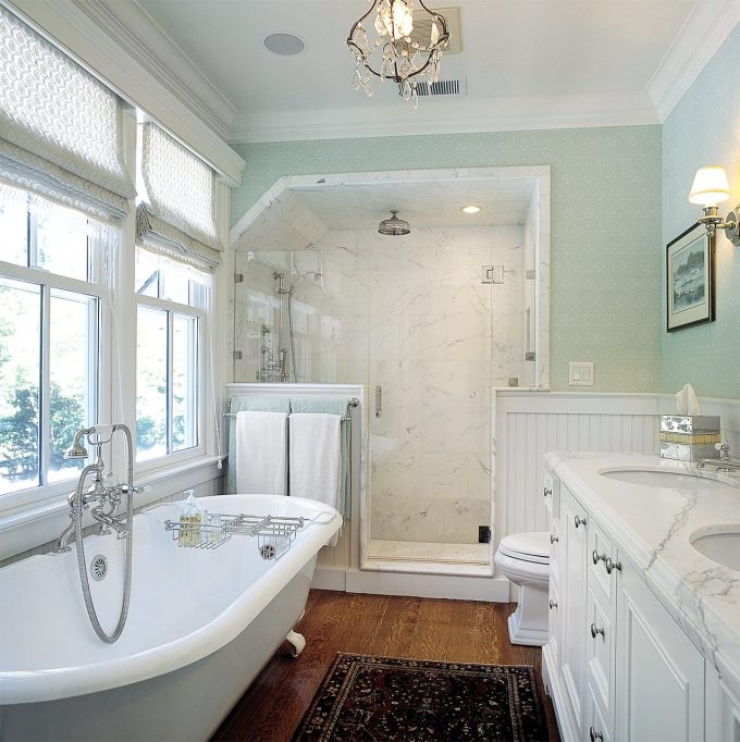 Beautiful Chandelier On White Ceiling Plus Crown Molding With Sconce On Blue Wall And Bathtub Caddy On Wood Flooring Also Walk In Shower Ideas With Recessed Lighting