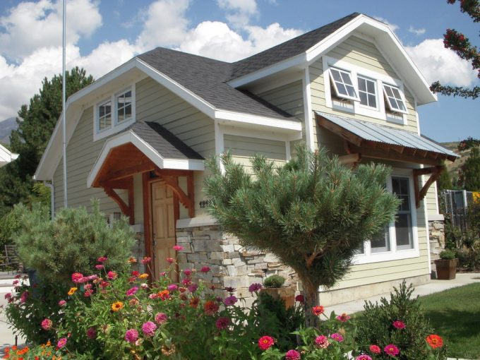 Beautiful Gardening And Flowers Plus Grass Also Exterior Cottage Ideas With Shed Roof Plus Awning Windows On Siding Wall Also Stone Wall With Wooden Door Plus Canopy