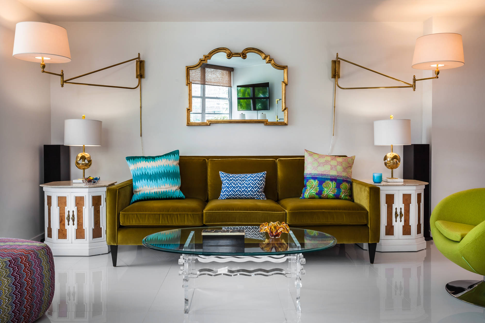 Blue Printed Throw Pillows On Green Velvet Sofa Plus Brass Table Lamps Also Lucite Coffee