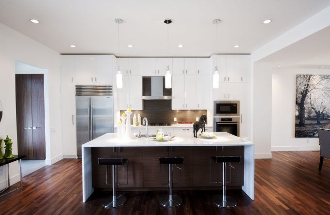 Brown Kitchen Island With White Quartz Countertops Plus Bar Stool And Hardwood Floorng As Kitchen Flooring Options With Recessed Lighting Also Pendant Lighting For Contemporary Kitchen
