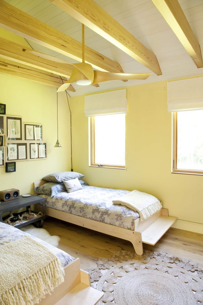 Ceiling Beams With Modern Ceiling Fan And Roman Blinds For Contemporary Kids Room Design With Kid Beds And Photo Collage Ideas Plus Wood Flooring Also Sheepskin Rug