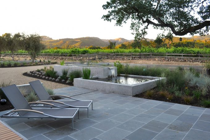 Chaise Lounge On Bluestone Pavers As Exterior Seating In Backyard With Backyard Oasis Also Backyard Landscaping Ideas Plus Gravel And Plants With Mountain View