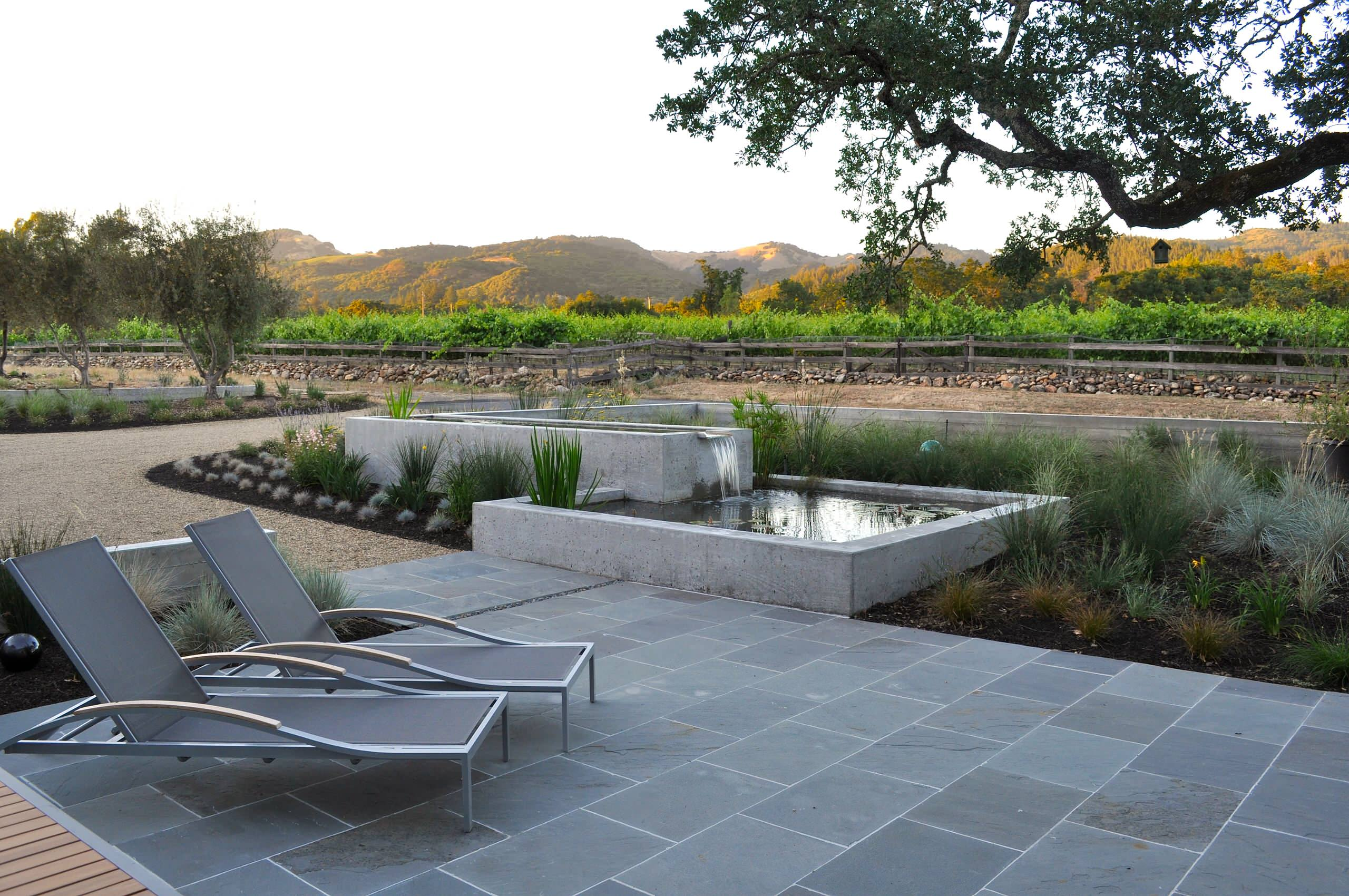 Bluestone Pavers Ideas For Patio Flooring: Chaise Lounge On Bluestone Pavers  As Exterior Seating In