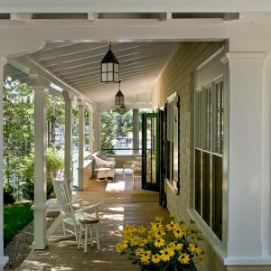 Coastal Cottage With Traditional Porch Designs For Summer And Vacation Plus Waterfront Also Porch Lights With Exposed Beams And Pillars Plus Patio Furniture