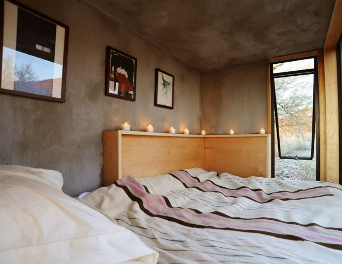 Contemporary Bedroom Designs In Mini House With Wall And Concrete Ceiling Plus Wall Decor Also Awning Windows With Candle On Corner Wood Headboard Plus Striped Bedding