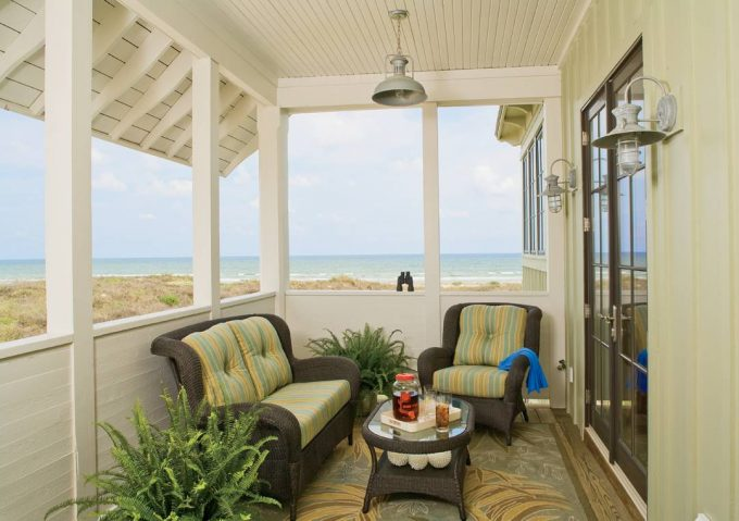 Cozy Small Porch With Area Rug And Wicker Furniture Plus Cushion Seat Also Wicker Coffee Table In Beach With Board And Batten Siding Plus Porch Lights And French Doors