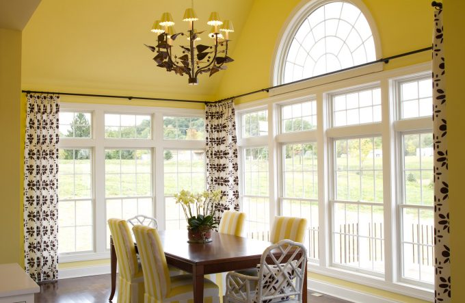 Curtain Rod And Pattern Curtain For Large Windows Plus Arc Window With Yellow Wall For Bright Dining Room Decor Plus Wood Dining Table And Stripes Upholstered Chairs Also Rattan Chairs
