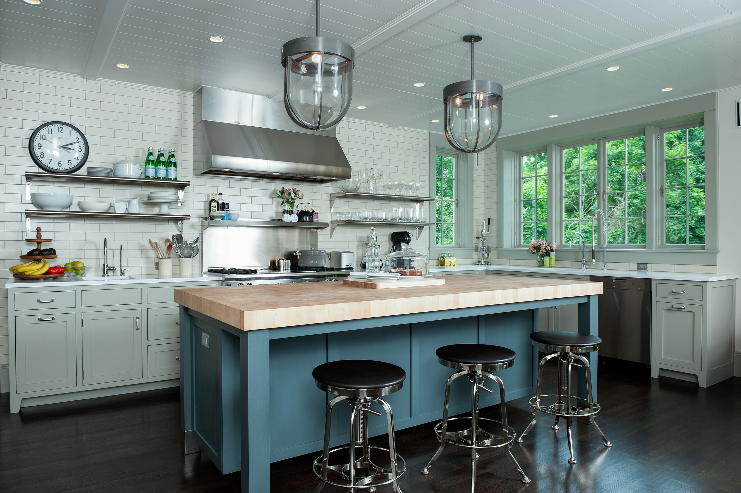 Dark Hardwood Floor With Custom Kitchen Islands And Modern Bar Stools In Traditional Kitchen With Pendant Lighting And Tile Wall Plus Hanging Shelves Also Paint Kitchen Cabinets