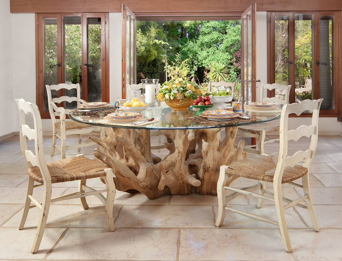 Driftwood Plus Round Glass Top For Dining Table On White Stone Flooring With Sisal Chairs Arrangement Flower And Dish Towels Also Plate