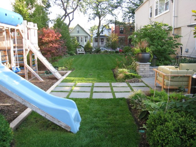 Exciting Backyard Landscaping Ideas With Flagstones For Walkway And Grass Plus Plants Also Potted Plant With Swing Sets For Children Playground Also Outdoor Sofa