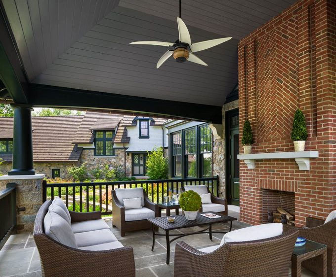Exterior Design For Traditional Porch With Black Pillar And Black Railing Plus Kingsley Bate For Woven Furniture With White Cushion And Red Brick Fireplace Plus Stone Fireplace Shelf