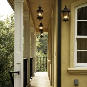 Exterior Designs With Arched Window And Yellow Stucco Plus Porch Lights Also Fluted Columns With Iron Railing And Tile Flooring For Tradirional Porch In Farmhouse