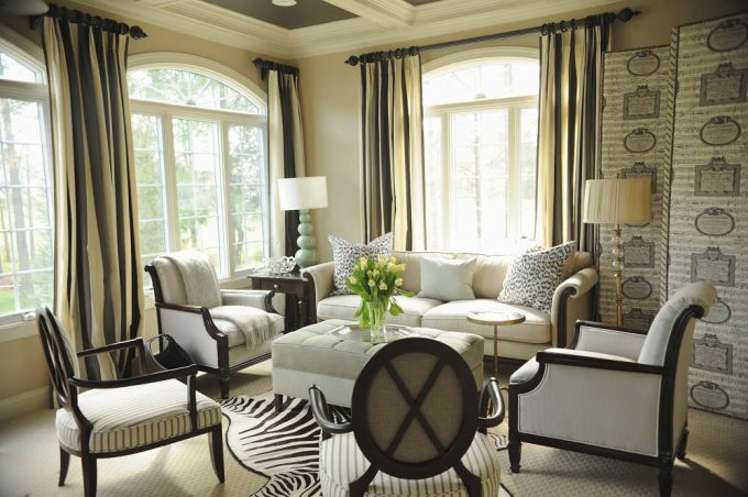 Fascinating Animal Decoration In Traditional Living Room With Leopard Print Cushion On Beige Sofa And Tufted Ottoman On Zebra Skin Rug With Gourd Table Lamp And Floor Lamp Also Curtain Rod Plus Striped Curtains