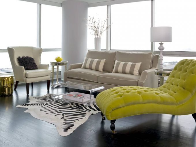 Hardwood Flooring For Trasitional Living Room Plus Zebra Rug And Lucite Coffee Table Also Chaise Longue With Mirrored Side Tables And Striped Pillows On Gray Sofa In Sunroom