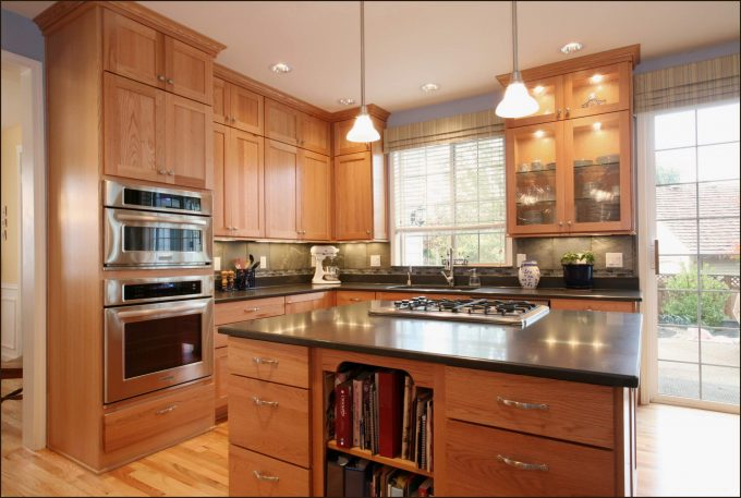 Interesting Kitchen Decoration With Glass Front Cabinets And Oak Cabinets Also Kitchen Island Plus Drawers With Wood Flooring And Kitchen Pendant Lighting Also Under Cabinet Lighting