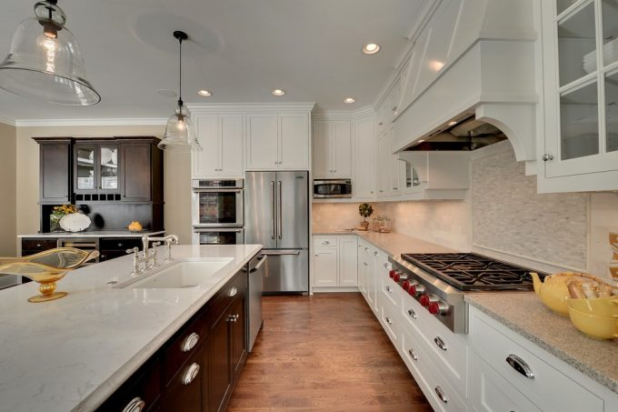Kitchen Renovation With Wood Flooring And Subway Tile Backsplash Plus Crown Point Cabinetry With Recessed Lighting And Bell Pendant Lighting Plus White Quartz Countertops Also Silver Hardware