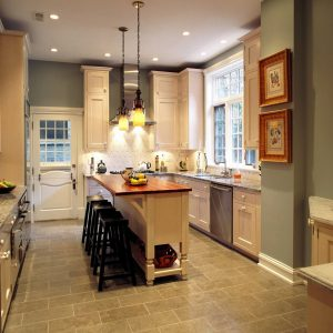 Laminate Tile Flooring With Custom Kitchen Islands And Wood Countertop In Traditional Kitchen With Bar Stools And Pendant Lighting Plus White Kitchen Cabinets Also Kitchen Knobs