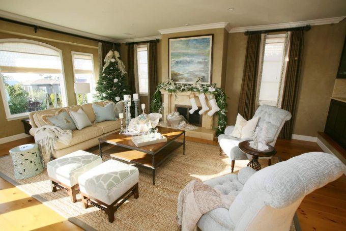 Living Room Decor Ideas With Arched Window And Wood Flooring Plus Sisal Carpet With Best Artificial Christmas Trees And Decorative Pillows On Tan Sofa Plus Silver Candle Holder On Coffee Table