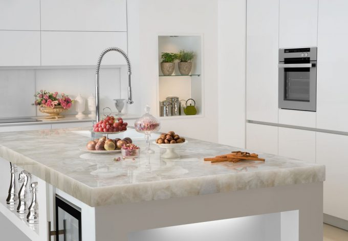 Marble Slab Cutting Board With White Quartz Countertops Plus Undermount Sink Also Faucet With Houseplants And Arrangement Flower For Garnish In Contemporary Kitchen
