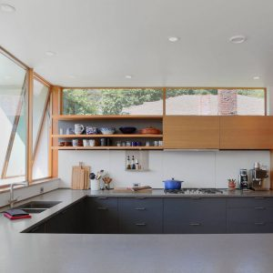 Modern Kitchen Ideas With Awning Windows Also Clerestory Windows And Basaltina Countertop Plus Undermount Sink With Custom Kitchen And Open Shelving With Concrete Flooring