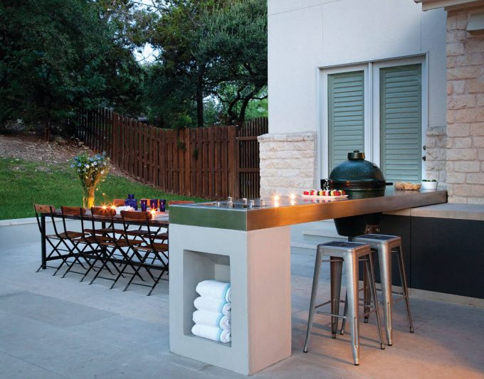 Outdoor Dining With Folding Dining Chairs And Metal Dining Table On Concrete Flooring Plus Candle Also Dish Towels With Stone Exterior And Wood Fence In Hill Plus Grass Also Tree