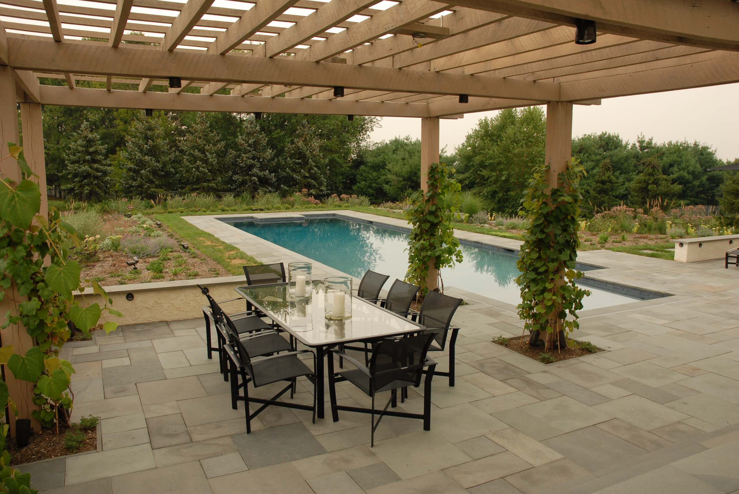 Decorating pool house designs and outdoor dining with for Best flooring for house with pool