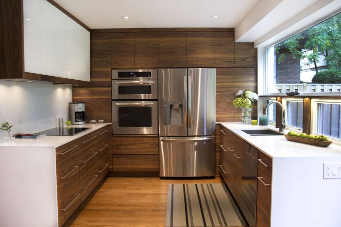 Small Kitchen Designs With Wood Flooring And Custom Cabinet Plus Bar Pull For Drawer Pulls Also White Quartz Countertops With Undermount Sink And Faucet Also Built In Refrigerator