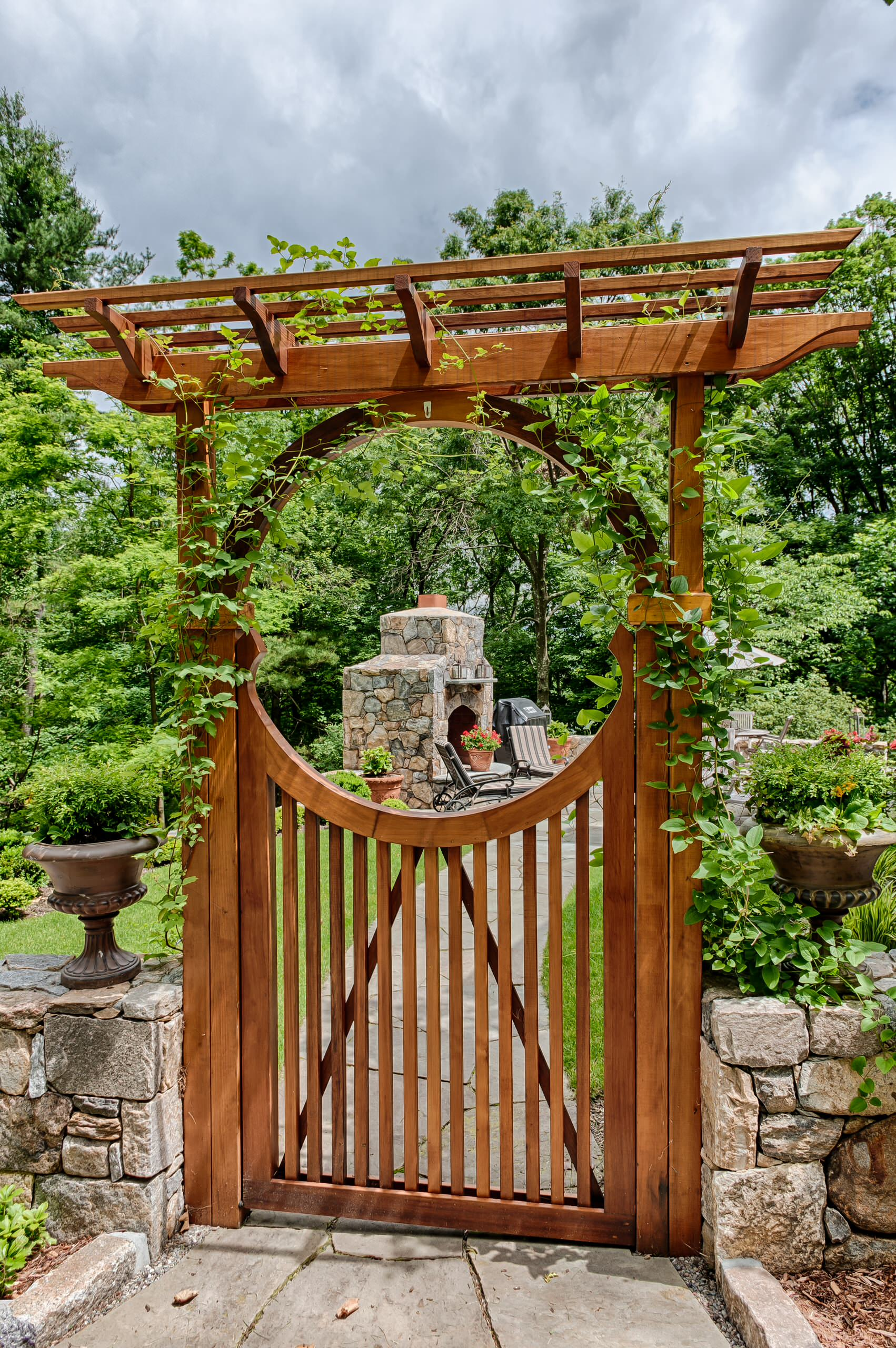 Doors Stone Fence With Wooden Gates And Stone Walkway For