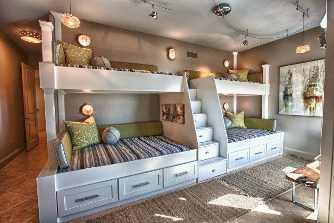 Storage Beds With Ladder Shelves And Wall Sconces For Beach Style Kids Room Design With Kid Beds And Pendant Lighting Plus Tile Flooring Also Sisal Carpet