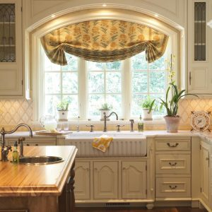 Traditional Kitchen With Window Treatments For Large Windows Plus Can Lights Also Reface Cabinets With Farmhouse Sink And Potted Plants Plus Wood Countertop On Wood Island