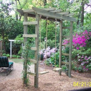 Traditional Landscape Ideas With Gravel Walkway Plus Arbor As Swing Sets And Annuals Also Hydrangea In Cottage Garden With Wooden Deck And Wood Railing Plus Lounge Chair