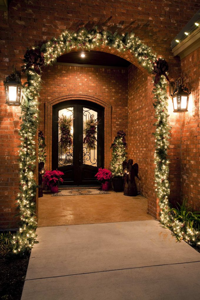 Traditional Porch With Christmas Decorating Also Christmas Lighting And Best Artificial Christmas Trees With Concrete Flooring For Exterior Brick Ideas Plus Double Glass Door