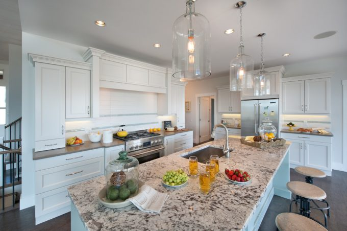 White Ice Granite With Bell Glass Pendants Also Dark Wood Floors And With Recessed Lighting Also White Kitchen Cabinets And Barstool Plus Kitchen Faucet For Traditional Kitchen