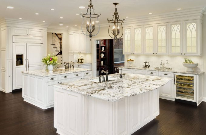 White Ice Granite With Cabinet Front Refrigerator Also Recessed Lighting And Crown Molding With Dark Wood Floors Also Double Islands And Under Cabinet Lighting Plus White Kitchen Cabinets For Traditional Kitch