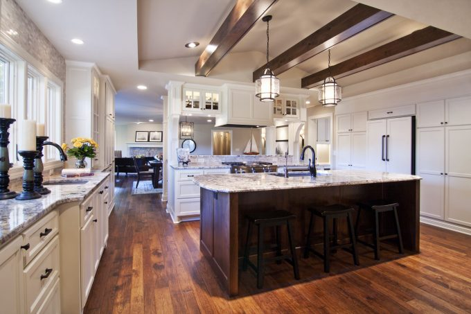 White Ice Granite With Recessed Lighting Also Dark Wood Floors And Range Hood With Pendant Lights Also White Tile Backsplash And Wood Beams Plus Barstool For Traditional Kitchen