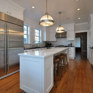 White Kitchen Cabinets With Ceiling Lights And Pendant Lighting In Traditional Kitchen With Custom Kitchen Islands And Kitchen Bar Stools Plus Modern Refrigerator Also Wood Floor