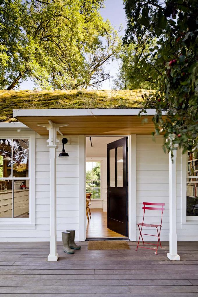 Wood Ceiling Plus Porch Lights With White Lap Siding And Black Front Door Plus Fluted Columns Also Cafe Chair For Charming Cottage With Deck In Front Porch Plus Green Roof