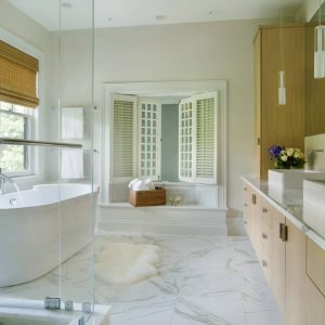 Above Counter Sink With Crema Marfil Marble Plus Bamboo Shades On Windows Also Calacatta Floor Tile For Contemporary Bathroom With Freestanding Tub And Pendant Lights