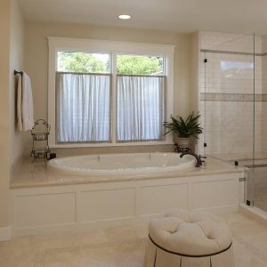 Accent Tile And Deck Mounted Faucet In Traditional Bathroom With Shaker Style Also Crema Marfil Marble Plus Shower Bench And Soaking Tub With Walk In Shower Also Window Treatments