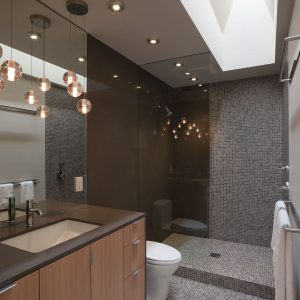 Accent Wall And Glass Shower Enclosures Plus Sheepskin Rug In Minimalist Bathroom With Mosaic Tiles And Open Shower Plus Skylights Also Bathroom Lighting Ideas With Wood Cabinets Plus Undermount Sink
