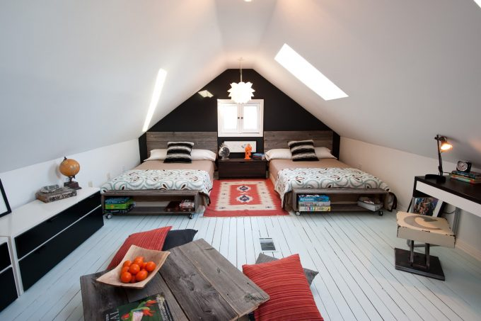 Accent Wall In Bedroom With Casement Windows Plus Dark Wall And Flat Woven Rug Also Floor Cushions In Loft With Reclaimed Wood Bed For Shared Bedroom Plus Skylights Also Vaulted Ceiling