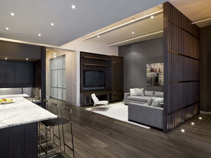 Accent Wall With Track Lighting And Cheap Room Dividers Also Gray Sofa And White Rug With Dark Wood Floors Plus Wall Unit And Bar Stools With Banquette Seating