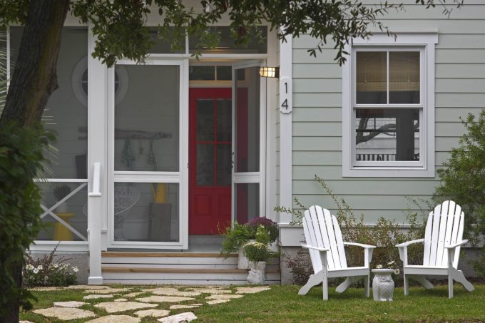 Adirondack Chair And Wall Sconce Also Double Hung Window With Flagstone And Gray Lap Siding Also Screen Doors Plus Round Window And Transom Window In Beach Style Entry