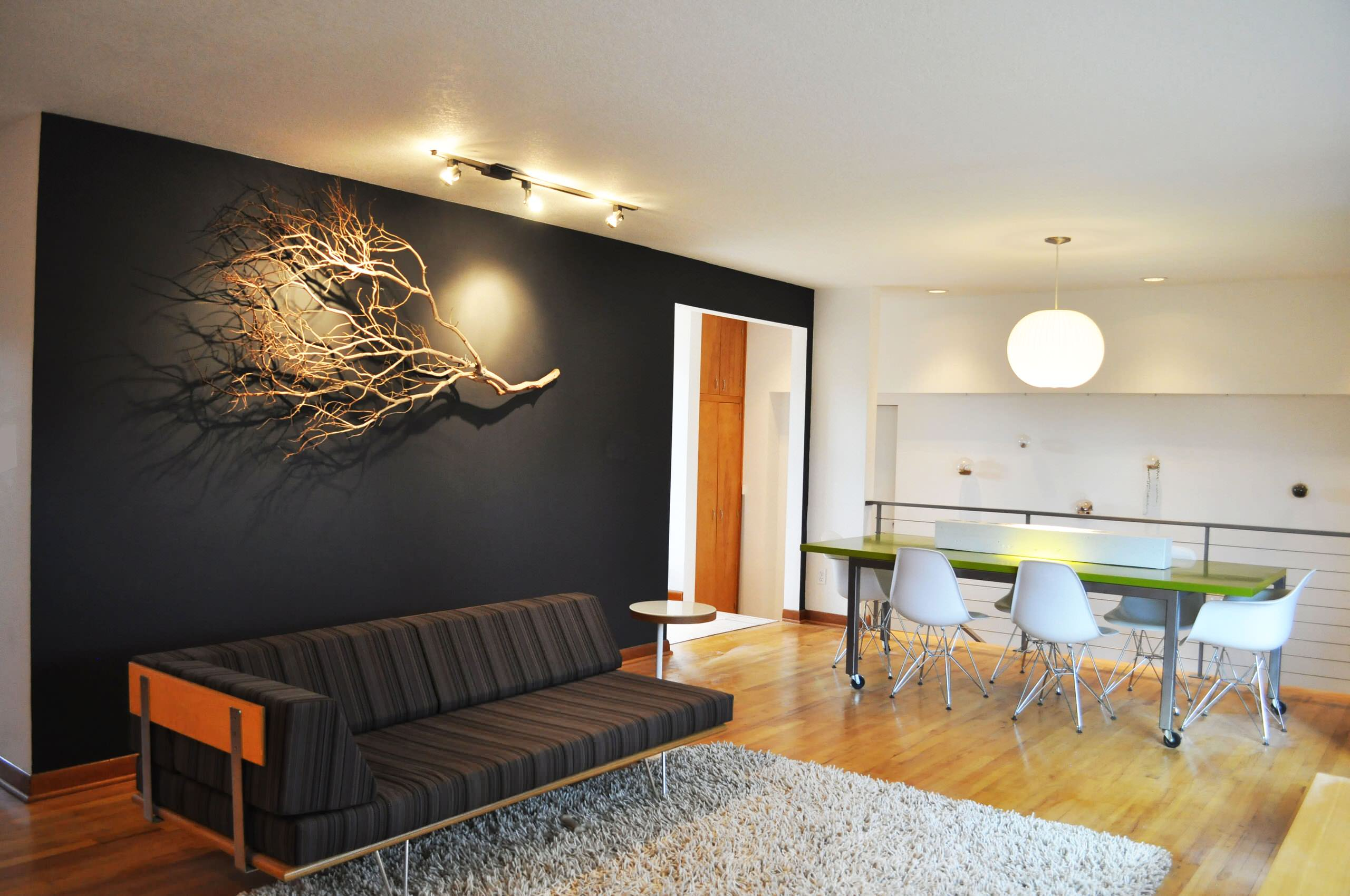Decorating Amazing Accent Wall With Branches Plus Ceiling Lighting
