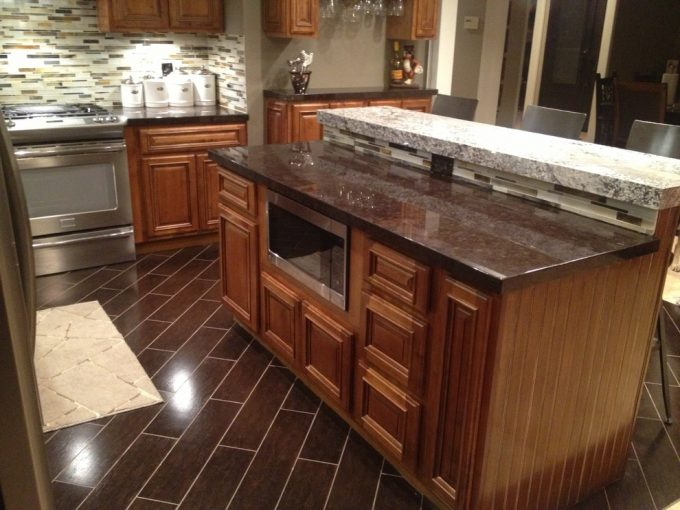Amazing Backsplash Ideas And Cinnamon Glaze Cabinets With Granite Countertop Also Kitchen Cabinets For Kitchen Remodel Plus Under Cabinet Microwave With Wood Looking Tile